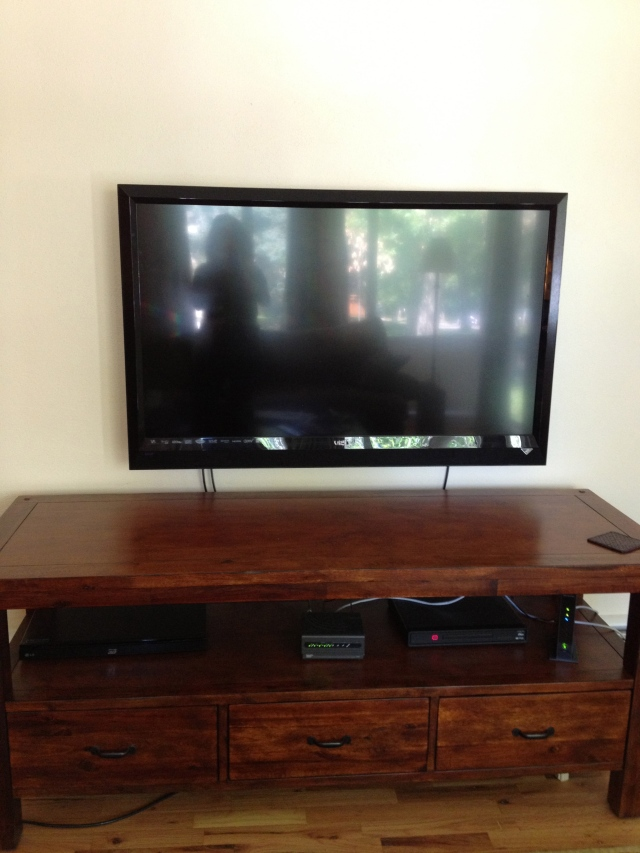 HD TV on wood stand