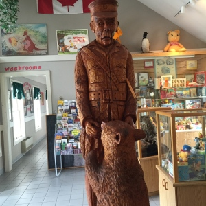 wooden statue of bear and soldier